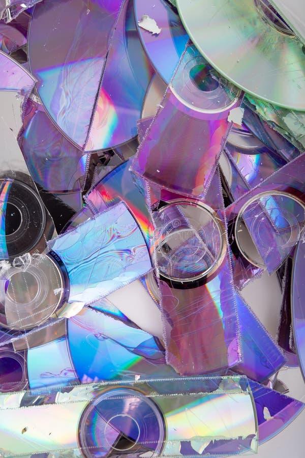 Диск Shredded данным по КОМПАКТНОГО ДИСКА и DVD стоковое изображение rf