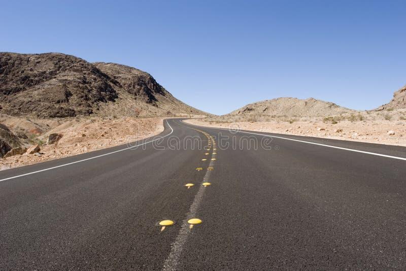 длинный путь пустыни стоковая фотография rf