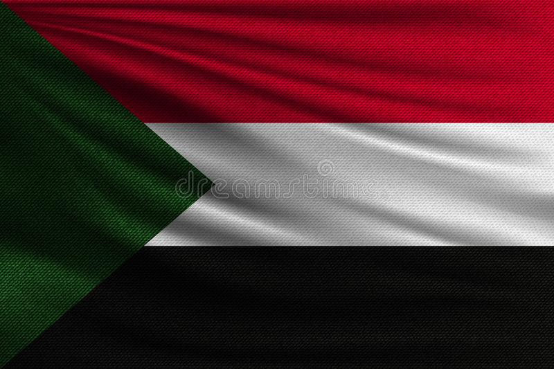 The national flag. Of Sudan. The symbol of the state on wavy cotton fabric. Realistic vector illustration royalty free illustration