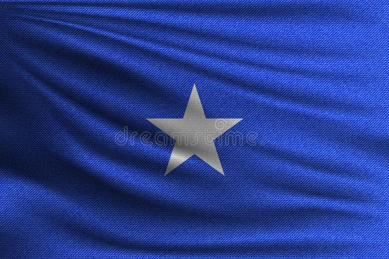 The national flag. Of Somalia. The symbol of the state on wavy cotton fabric. Realistic vector illustration royalty free illustration