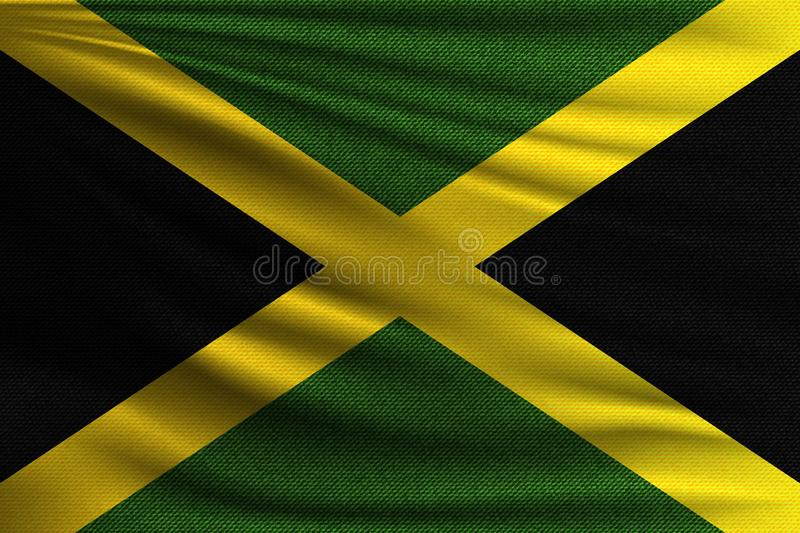 The national flag. Of Jamaica. The symbol of the state on wavy cotton fabric. Realistic vector illustration royalty free illustration