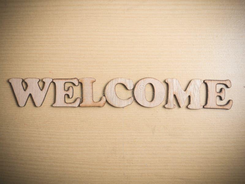 Добро пожаловать в деревянной концепции слова стоковые изображения
