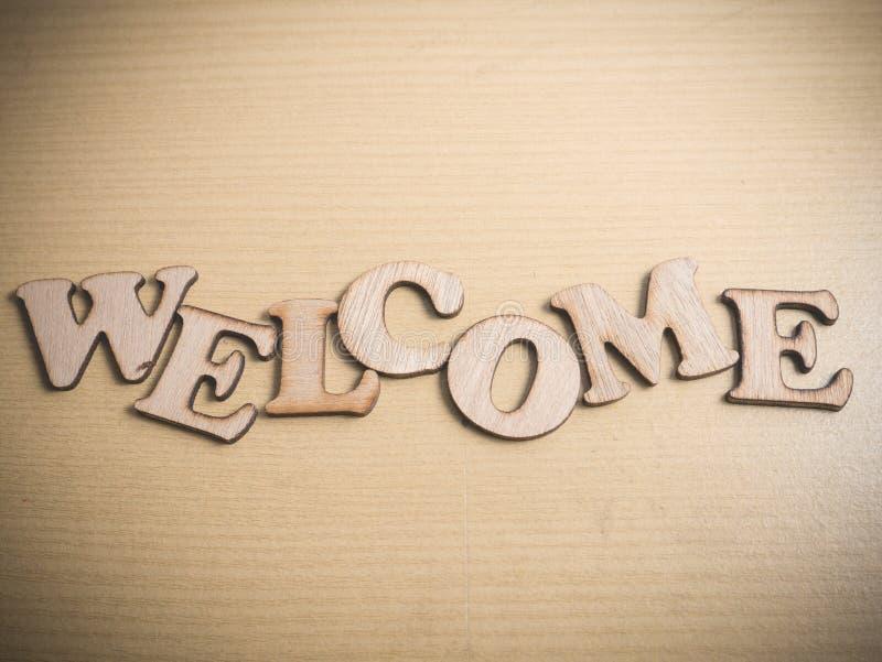 Добро пожаловать в деревянной концепции слова стоковое изображение