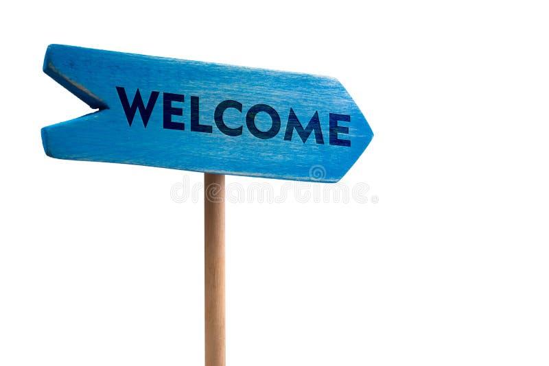 Добро пожаловать деревянная стрелка доски знака стоковые фотографии rf