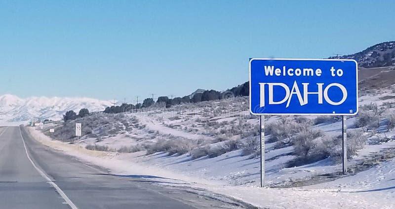 Добро пожаловать к знаку государственной границы Айдахо стоковые фотографии rf