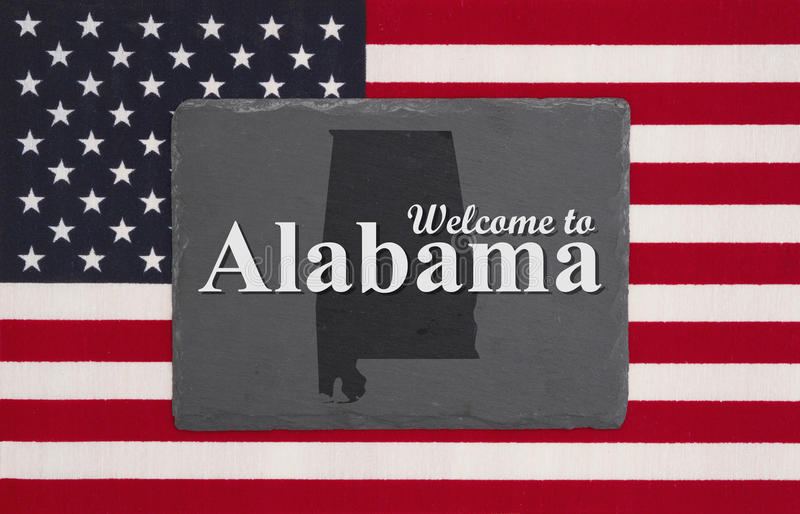 Добро пожаловать к сообщению Алабамы с флагом стоковые изображения rf