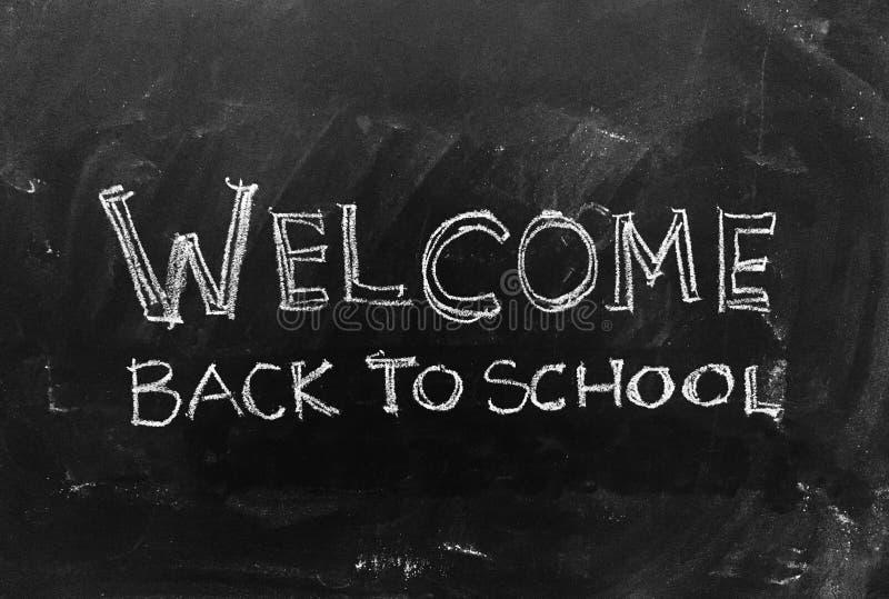 Добро пожаловать назад к школе - почерку на классн классном как запас Imag стоковая фотография