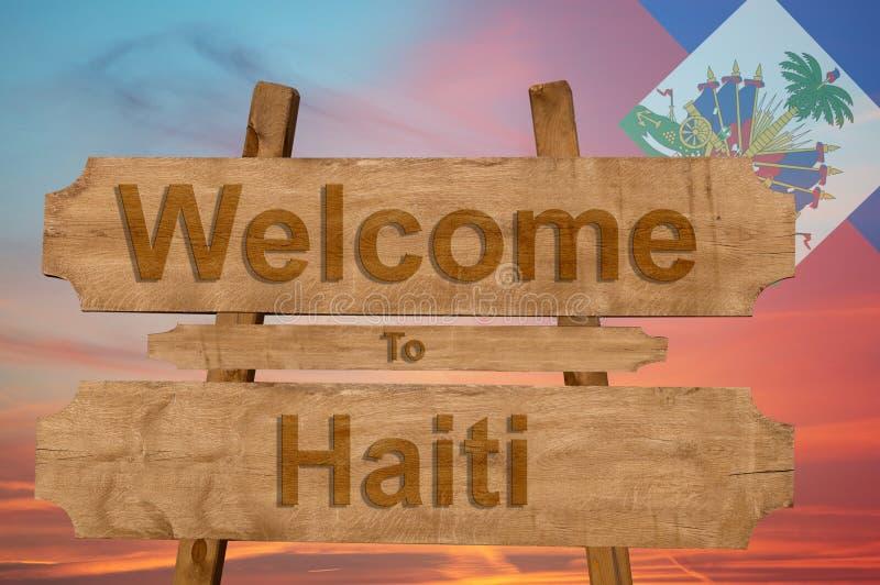 Добро пожаловать к Гаити поет на деревянной предпосылке с смешивая национальным флагом стоковые изображения rf