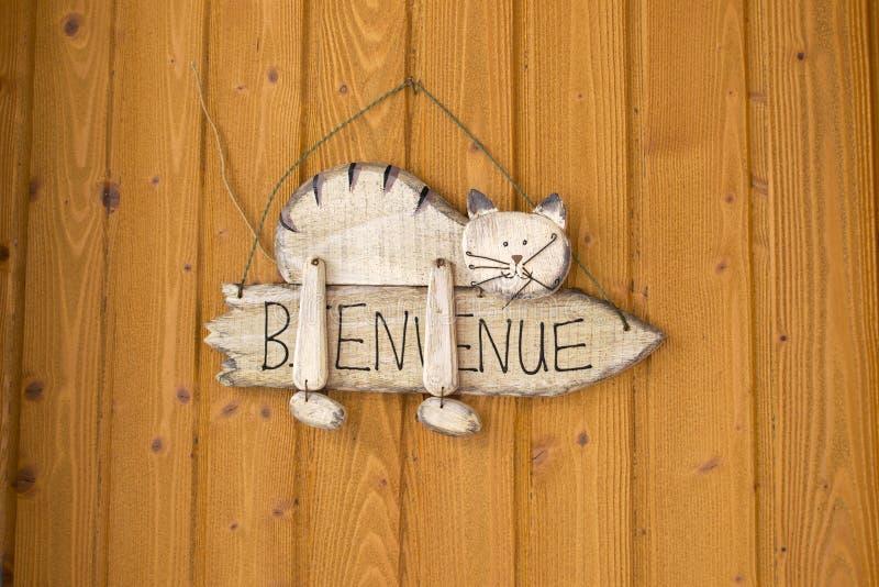 Добро пожаловать дом в французском стоковое фото rf