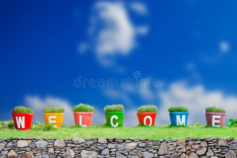 Добро пожаловать слово сделанное от Jardiniere стоковое изображение