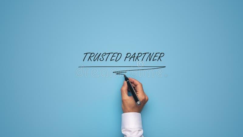 Доверенная предпосылка знака партнера сверх голубая стоковая фотография rf