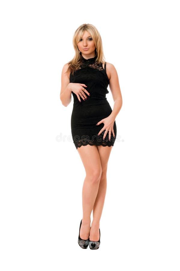 Довольно белокурая девушка в черноте стоковая фотография rf