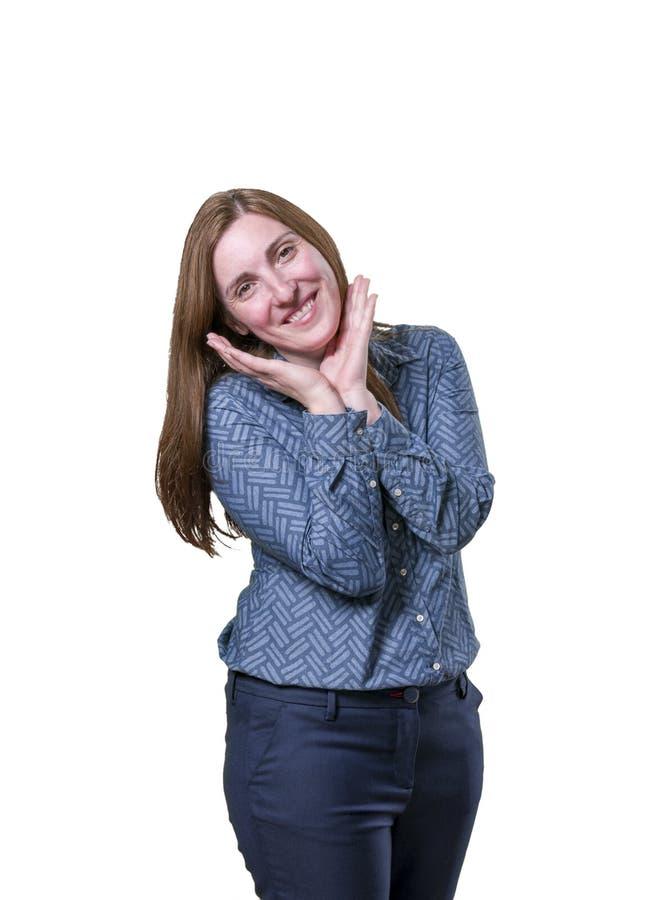 Довольно молодая коммерсантка счастлива над белой предпосылкой стоковое фото rf