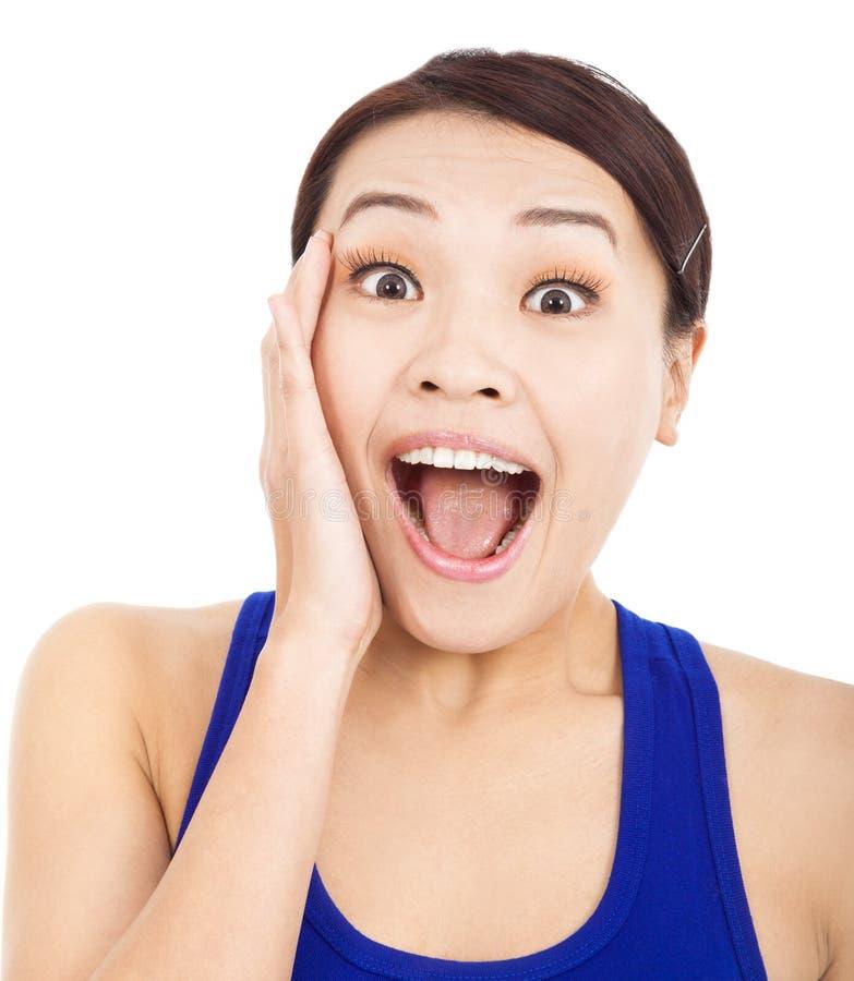 Довольно азиатским выражение лица женщины удивленное чувством стоковое фото rf
