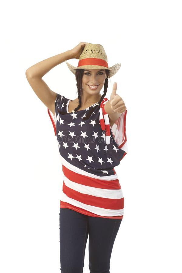 Довольно американская девушка в шляпе стоковая фотография rf