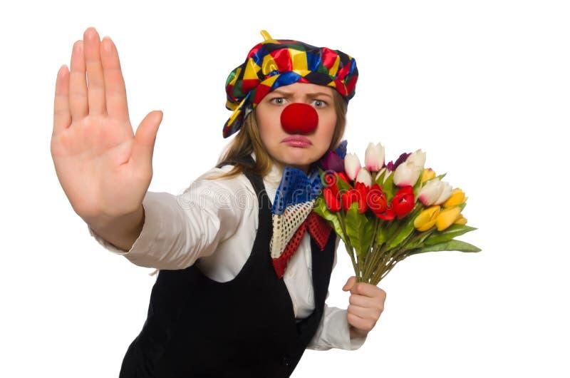Довольно женский клоун при цветки изолированные на белизне стоковое изображение