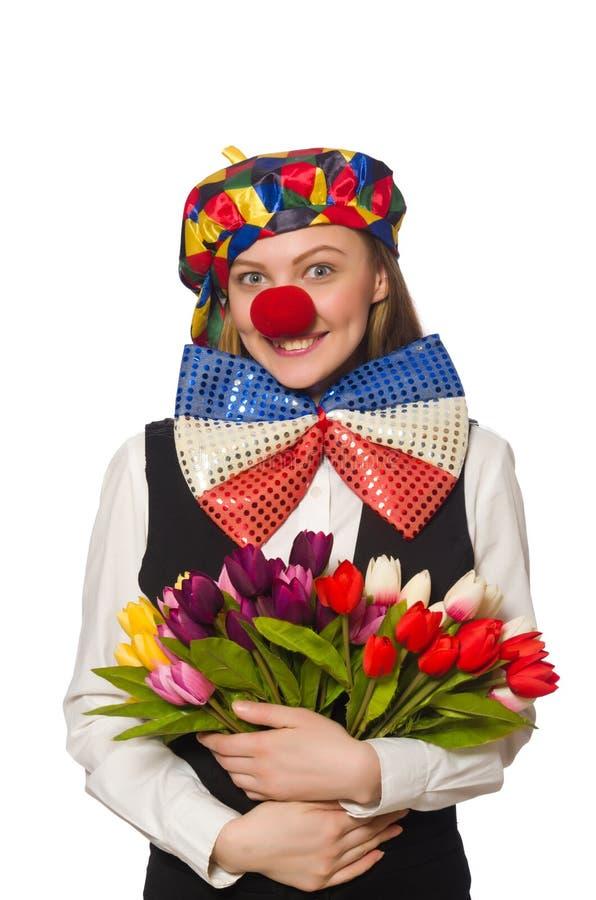 Довольно женский клоун при цветки изолированные на белизне стоковая фотография