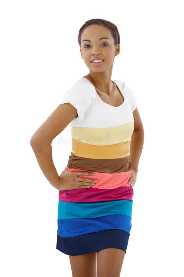 Довольно этническая женщина в красочном платье стоковое изображение rf