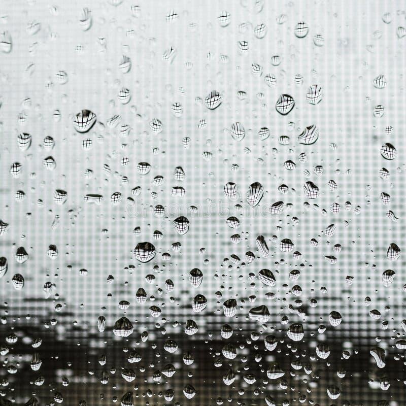 Дождевые капли на экране окна стоковое фото rf