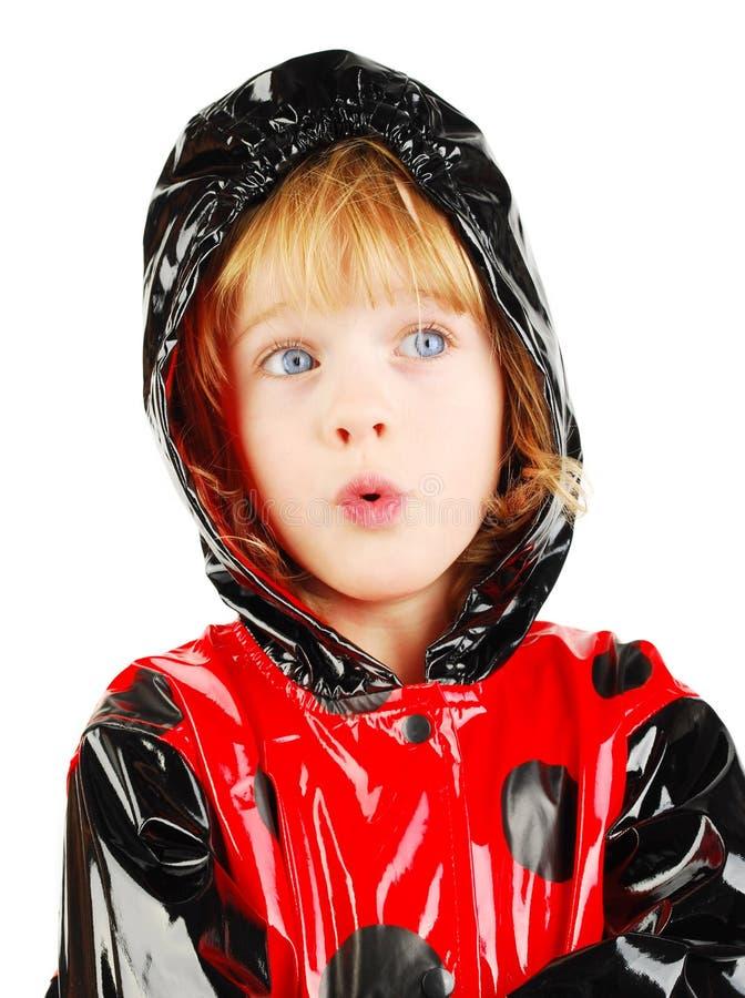 дождь пальто ребенка стоковое фото