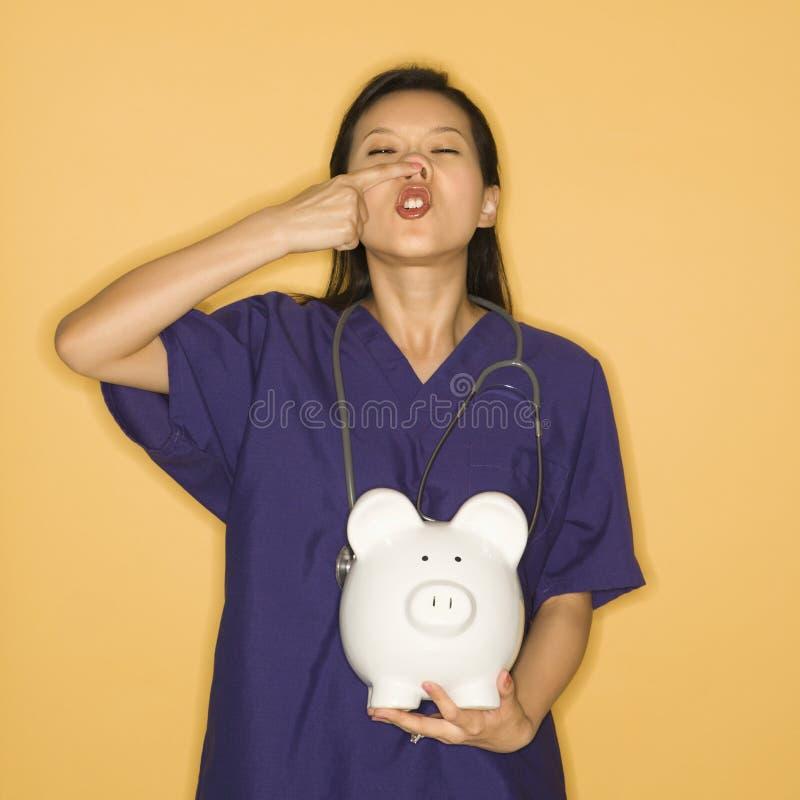 доктор банка piggy стоковые изображения