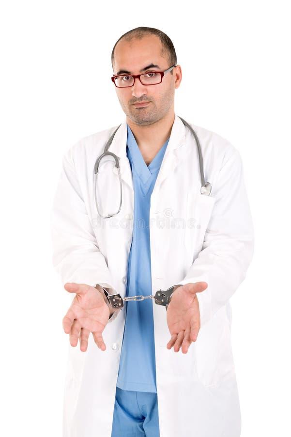 Доктор в наручниках стоковая фотография