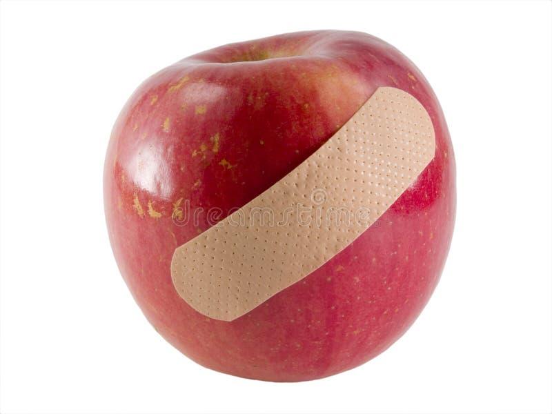 доктор дня яблока отсутствующий держит стоковое изображение