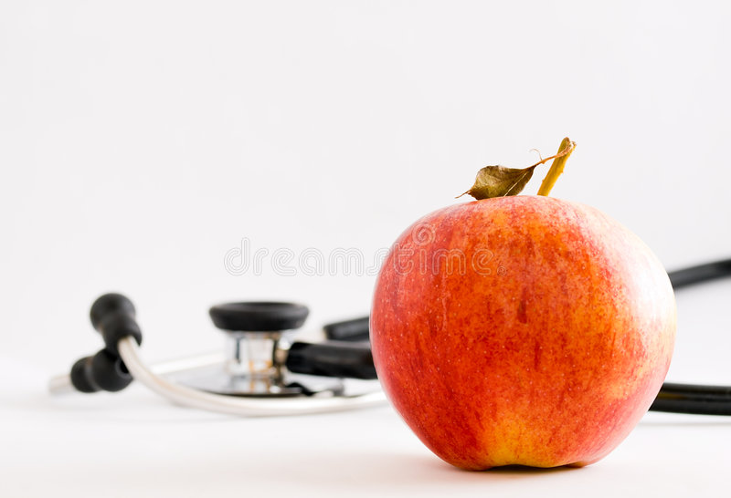 доктор дня яблока отсутствующий держит стоковое изображение rf