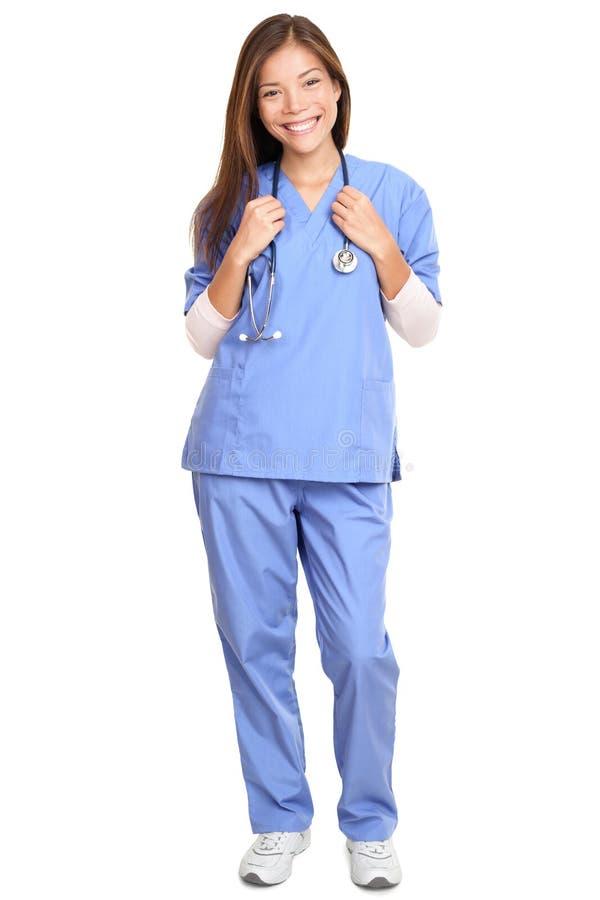 Доктор - женский хирург с усмехаться стетоскопа стоковая фотография