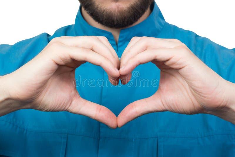 Доктор имеет его руки в форме сердца стоковая фотография