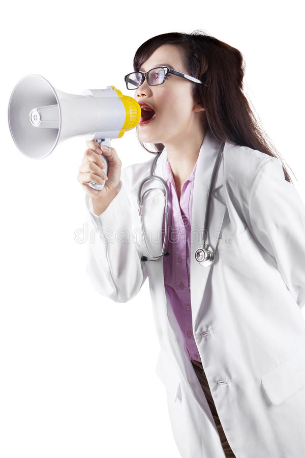 Доктор крича на мегафоне стоковая фотография rf