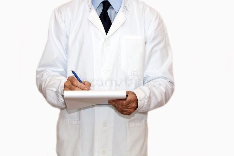 Доктор пишет историю болезни стоковое изображение