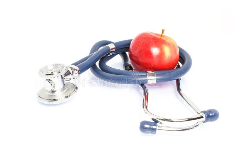 доктор стетоскопа стильный с яблоком на белой предпосылке стоковое фото rf