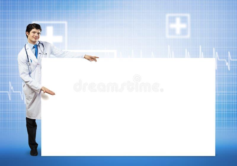 Доктор с знаменем стоковое фото rf