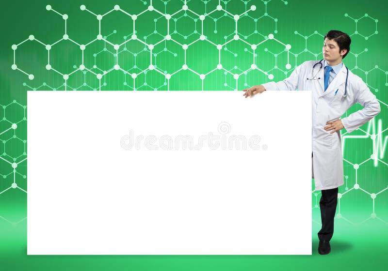 Доктор с знаменем стоковое изображение