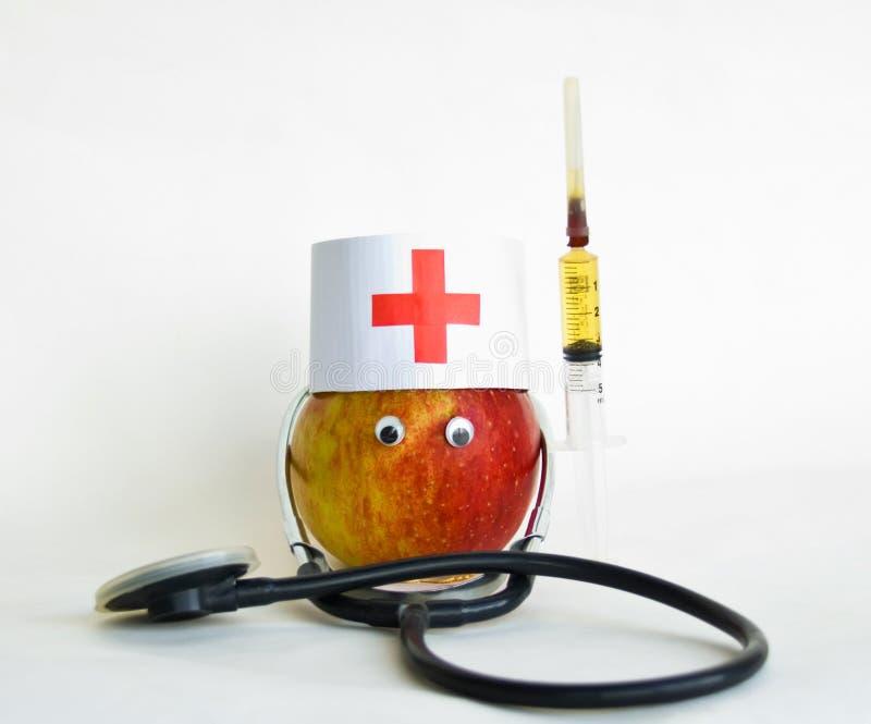 доктор яблока стоковое изображение