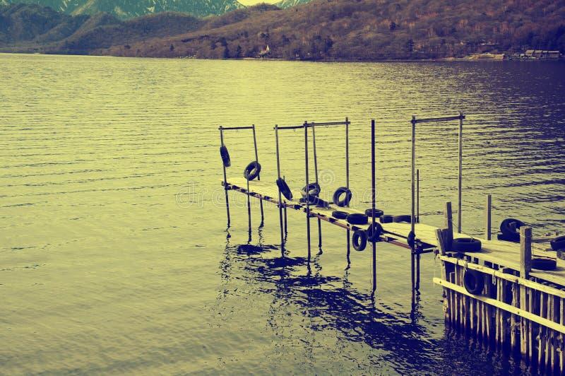 Док рыбной ловли - винтажное влияние стоковое фото