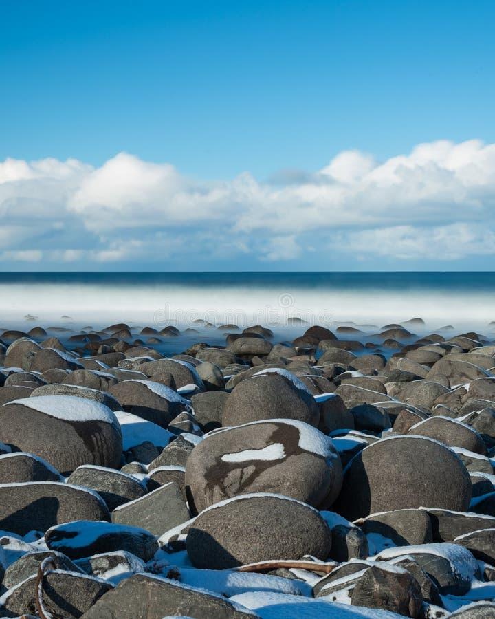 Долгая выдержка на пляже Unstad в островах Lofoten, Норвегии стоковая фотография