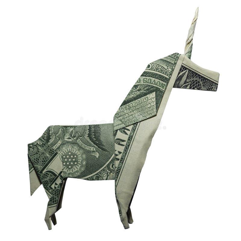 Долларовая банкнота ЕДИНОРОГА Origami денег мистическая животная реальная одна изолированная на белой предпосылке стоковая фотография rf