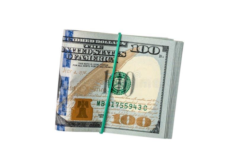 Долларовые банкноты совместно изолированной круглой резинкой стоковое изображение rf