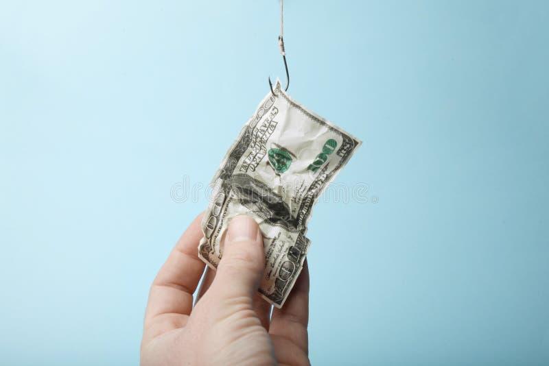 100 долларов на крюке ловушка Зависимость на займах и кредитах стоковые изображения rf