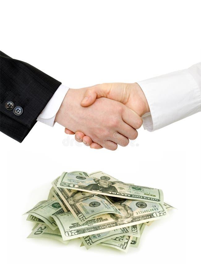 доллары вороха рукопожатия стоковая фотография rf