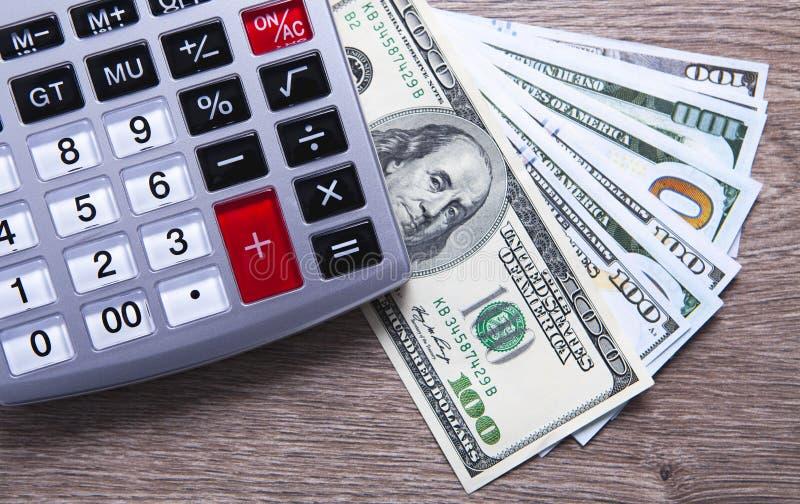 Доллары и калькулятор стоковая фотография rf