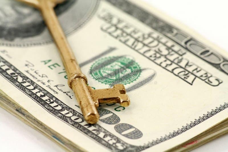 доллары ключа золота стоковое фото