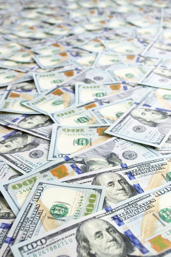 Доллары предпосылки кучи стоковые фото