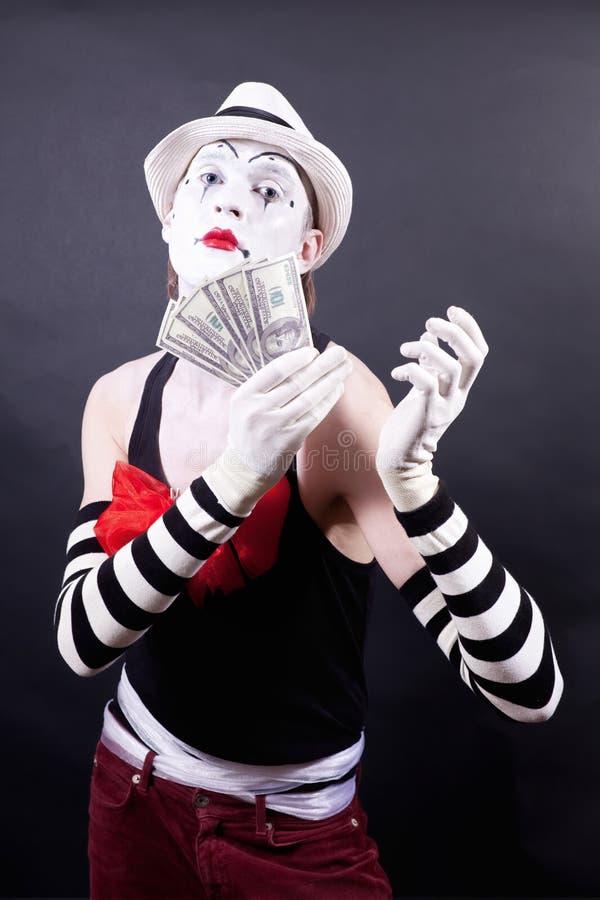 доллары рук mime theatrical их стоковые изображения rf