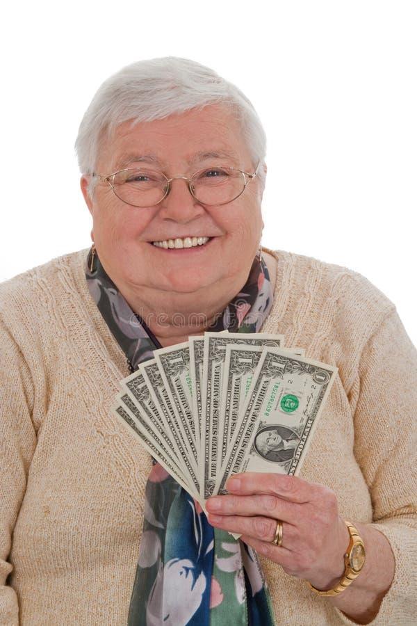 доллары форматируют старшую вертикальную женщину стоковое изображение rf