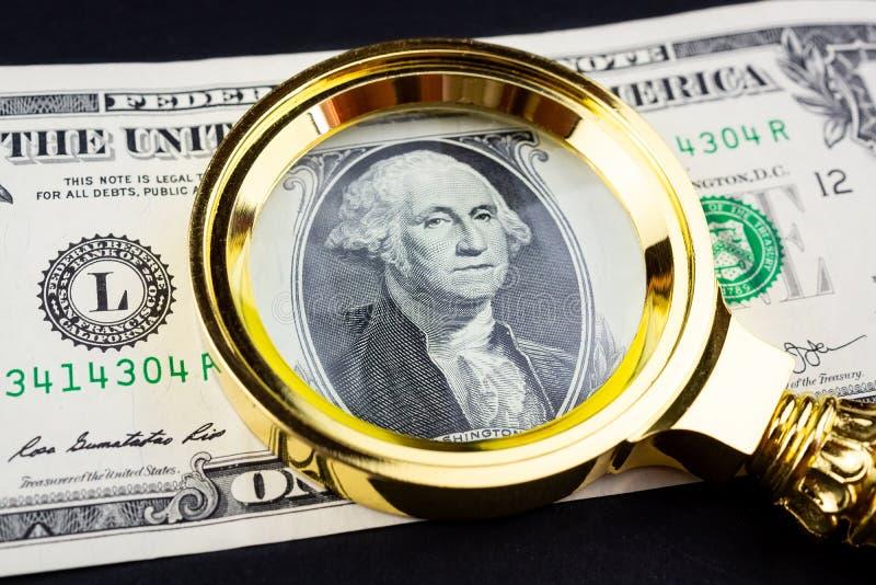 Доллар и лупа стоковые изображения rf
