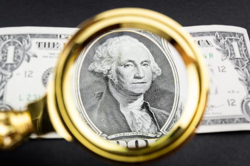 Доллар и лупа стоковые фотографии rf