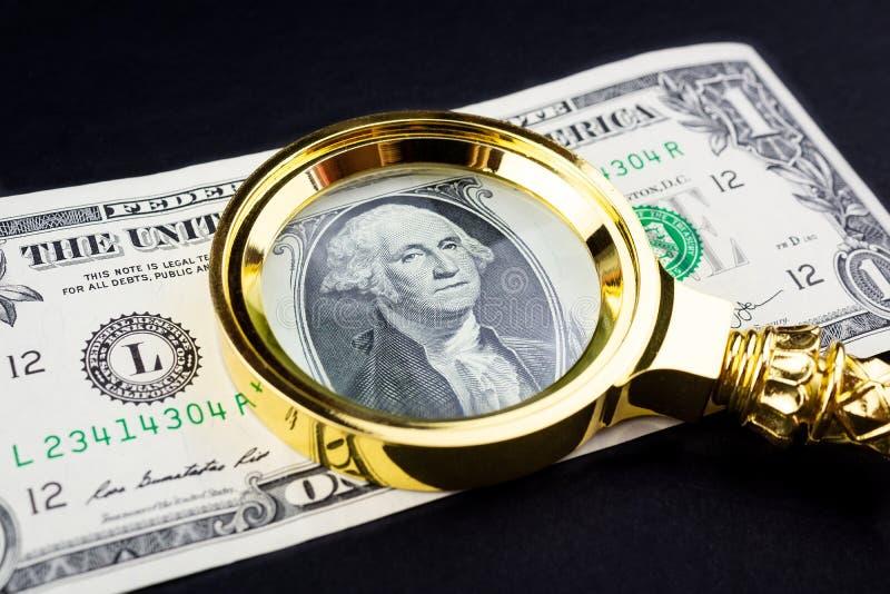Доллар и лупа стоковое фото rf